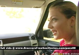 glamorous redhead sweetheart in the car