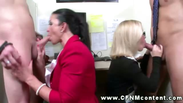 two classy clothed secretaries help their bosses