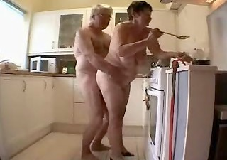 old pair having pleasure in the kitchen