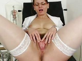 unshaved mom wears glasses and nurse uniform