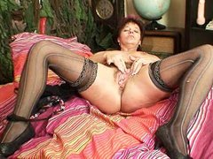 mature non-professional mom squeezing her bawdy