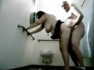 chap fucks a granny in public toilets