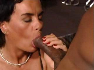 brunette german milf eats a black cock and gets