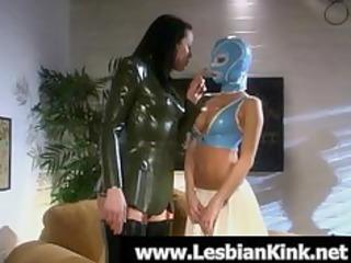 lesbians in rubber garments drubbing booties