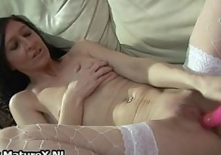 slim old housewife stuffing a large pink part3