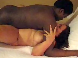 north indian wife wraps her feet around a large
