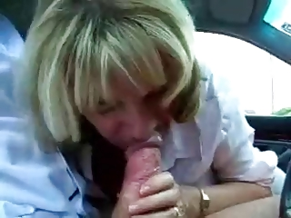 mature secretary cheats with her boss at the car