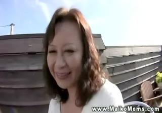 cute japanese milf shows stranger her underware