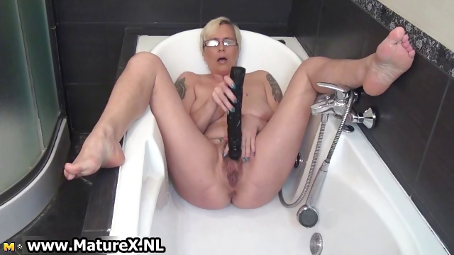 sexually excited aged lady fucking her own tight