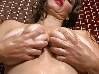 lusty large breasted milf wench masturbates